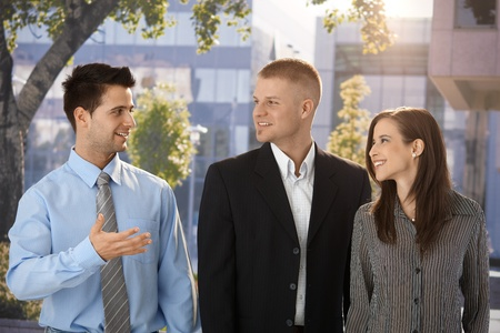 Outdoor portrait of happy businesspeople, standing in front of office building. Stock Photo - 9564415
