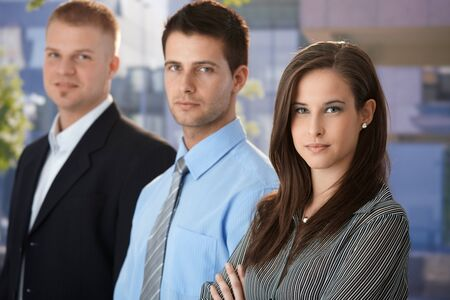 Outdoor portrait of confident young businesspeople , looking at camera. photo