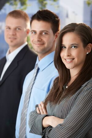 Smiling businesspeople standing outdoors, looking at camera. Stock Photo - 9564412
