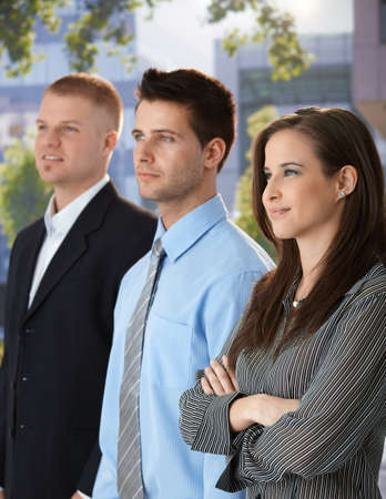 Outdoor portrait of successful and confident businesspeople standing together, smiling. Stock Photo - 9564271