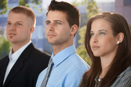 Outdoor team portrait of determined and young businesspeople. Stock Photo - 9563314