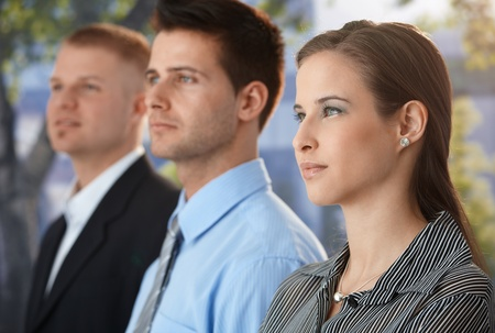 Portrait of determined business group standing outside of office. Stock Photo - 9563390