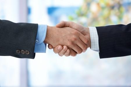 Businessmen shaking hand, closeup hands, business success, congratulation, agreement, deal. Stock Photo - 9563015