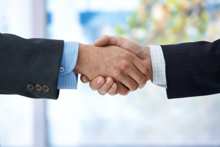 Businessmen shaking hand, closeup hands, business success, congratulation, agreement, deal. photo