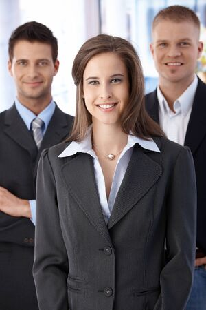 Official business team portrait, confident, smiling businesspeople standing in office. Stock Photo - 9564667