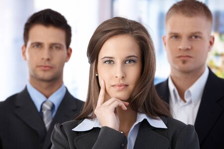 Portrait of determined business team, focus on attractive businesswoman. Stock Photo - 9564105
