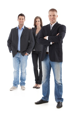 casual caucasian: Goodlooking young casual businesspeople posing in studio, smiling, looking at camera, cutout, full length.
