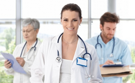 eye care professional: Female doctor leading medical professionals.�