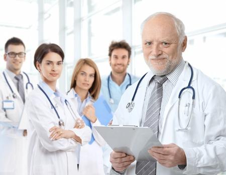 Portrait of aged male doctor teaching medical students.� Reklamní fotografie