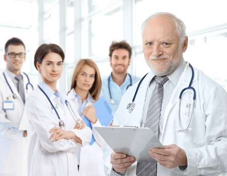 Portrait of aged male doctor teaching medical students.� Stock Photo - 9654888
