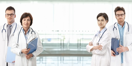 Team of medical professionals, copyspace in center.� Stock Photo - 9654891
