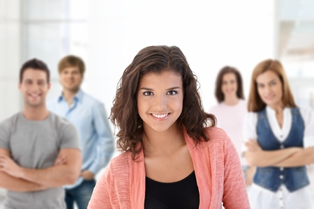 highschool: Group of happy college students looking at camera, smiling.�