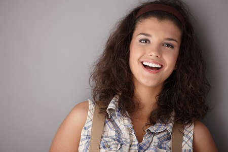 Beautiful young female smiling happily, looking at camera. Stock Photo - 9714141