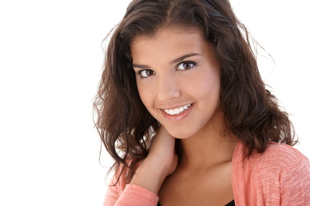 Portrait of attractive young woman smiling, looking at camera. photo