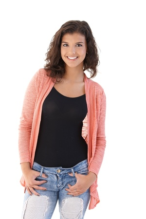 only teenage girls: Happy student standing, smiling, looking at camera. Stock Photo