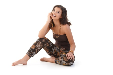 woman sitting floor: Happy woman at summertime, sitting on floor. Stock Photo