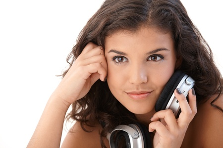 seventeen: Portrait of beautiful young woman with headphones, smiling. Stock Photo