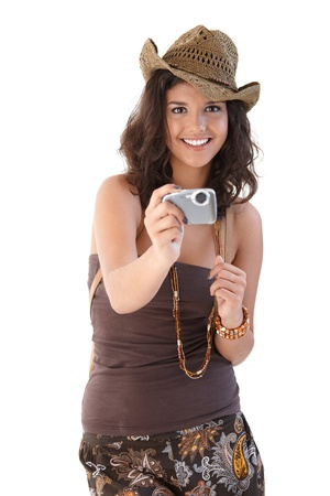 only teenage girls: Beautiful young girl taking photo, smiling. looking at camera.