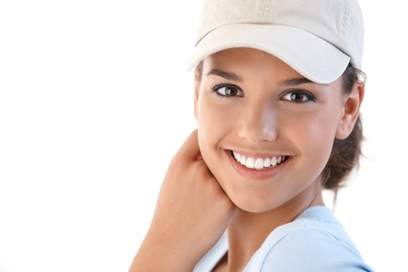 teenagers only: Portrait of beautiful young smiling woman, looking at camera.