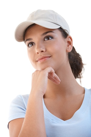 Portrait of young attractive female in baseball cap. photo