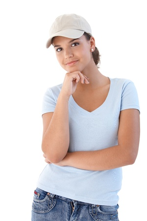 teenagers only: Young woman smiling, looking at camera. Stock Photo