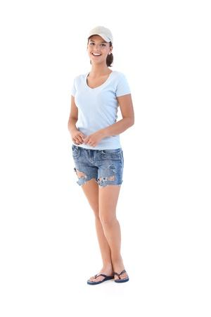 shorts: Colegiala en cortos en verano, sonriendo, mirando a la c�mara.