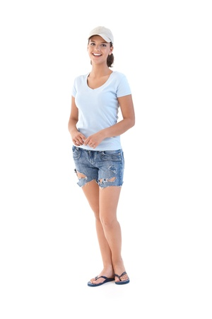 only teenage girls: Schoolgirl in shorts at summertime, smiling, looking at camera.