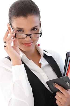 segretario: Imprenditrice sexy sorridente da dietro gli occhiali.