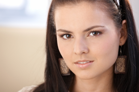 severity: Closeup portrait of pretty young girl looking at camera. Stock Photo