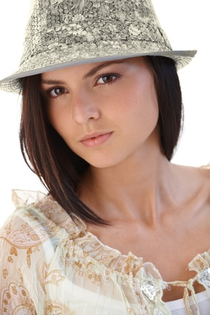 offish: Closeup portrait of young woman in hat.