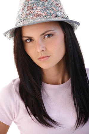offish: Young woman wearing hat, looking at camera.�