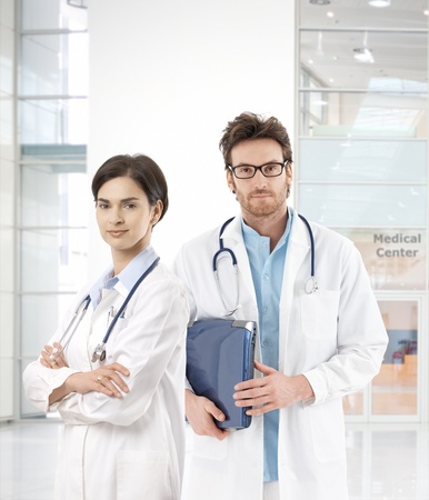 Portrait of confident young doctors in medical center, looking at camera.� photo