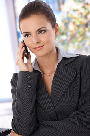 Pretty young woman talking on mobile phone. Stock Photo - 9868338