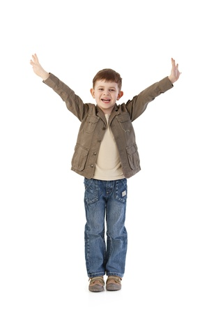 have on: Happy little kid standing with arms wide open, smiling happily.