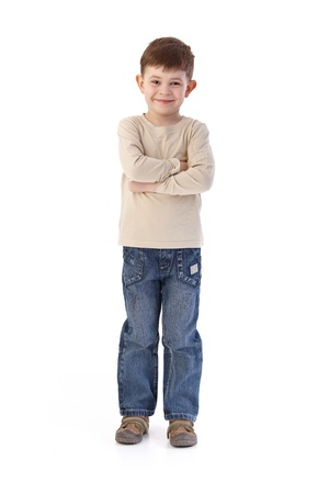 boy standing: Sweet little boy smiling arms crossed, looking at camera.