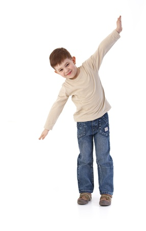 only boys: Five year old little boy imitating flying as an airplane, smiling. Stock Photo