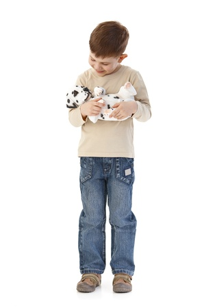 Happy boy holding a Dalmatian dog, smiling. photo