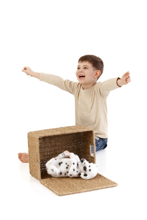 box size: Little boy opening box, yelling happily at dog, laughing.