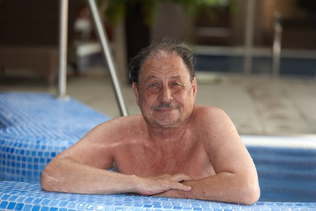 Portrait of mature man smiling in swimming pool. Stock Photo - 9868588