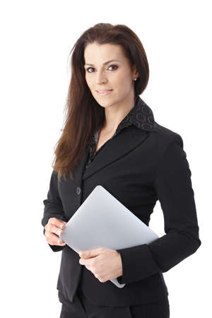 Businesswoman holding tablet pc smiling at camera. photo