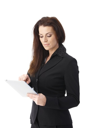 only mid adult women: Smart businesswoman using touchscreen computer, isolated on white. Stock Photo