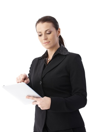 Smiling smart businesswoman using tablet pc, cutout on white, low angle view. photo