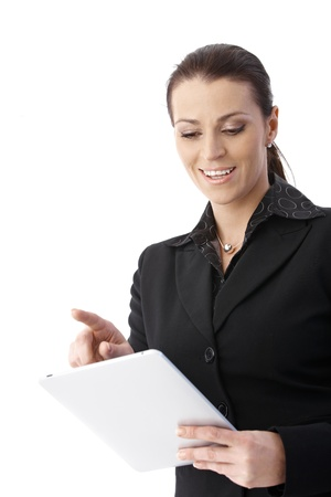 Cheerful businesswoman using tablet computer, smiling. photo