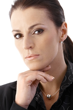 offish: Closeup portrait of determined businesswoman looking at camera.