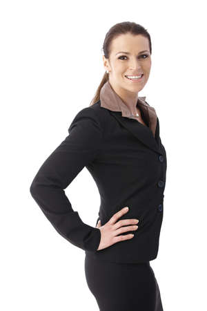 Happy middle-aged businesswoman posing with hands on waist, laughing, isolated on white. photo
