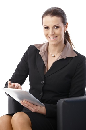 Portrait of happy businesswoman using touchscreen tablet computer, looking at camera. Stock Photo - 9868437