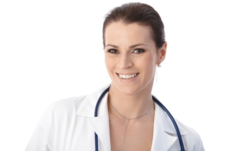 Portrait of female physician smiling at camera, white background. Stock Photo - 9868530