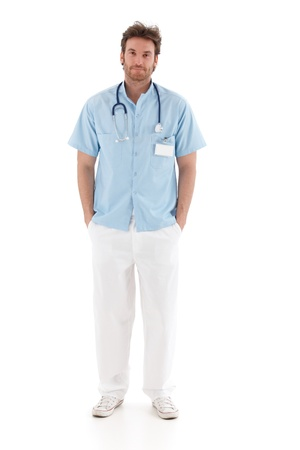 consultant physicians: Handsome young doctor standing with hands in pocket, smiling.