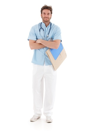 image size: Smiling doctor standing arms crossed, holding papers.
