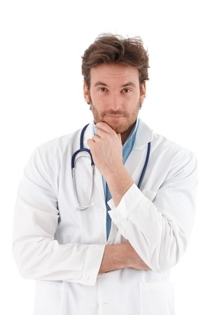 males only: Handsome young doctor looking questioningly at camera. Stock Photo